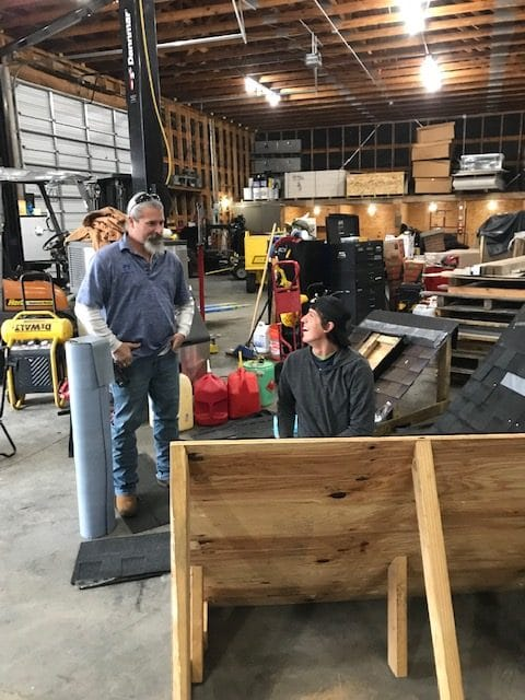 Commercial roofers working in the shop