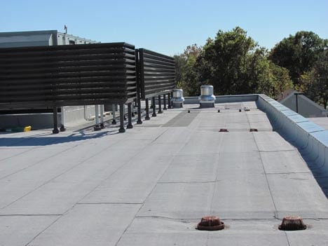 Polymer-modified bitumen system being installed by commercial contractor Benton Roofing