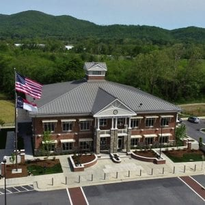 Drone picture of a standing seam metal roof on a town hall