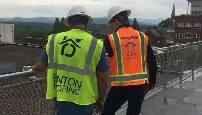 Commercial roofer in a safety vest